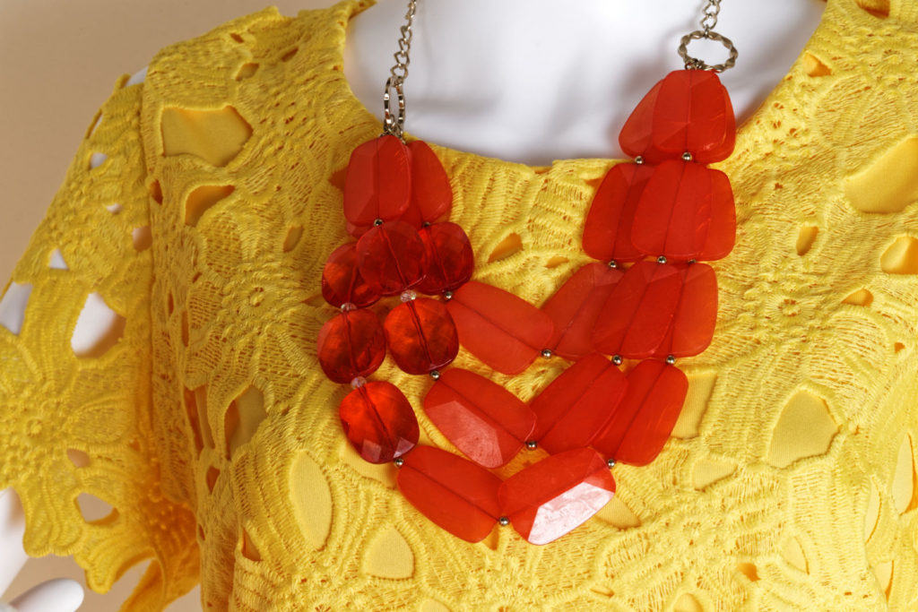Orange necklace on yellow dress