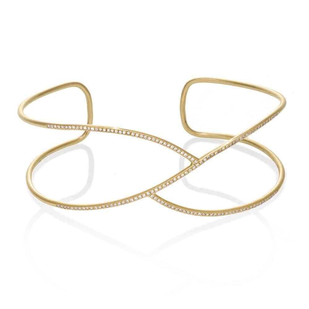 a curvy diamond and gold cuff by Jen Hansen