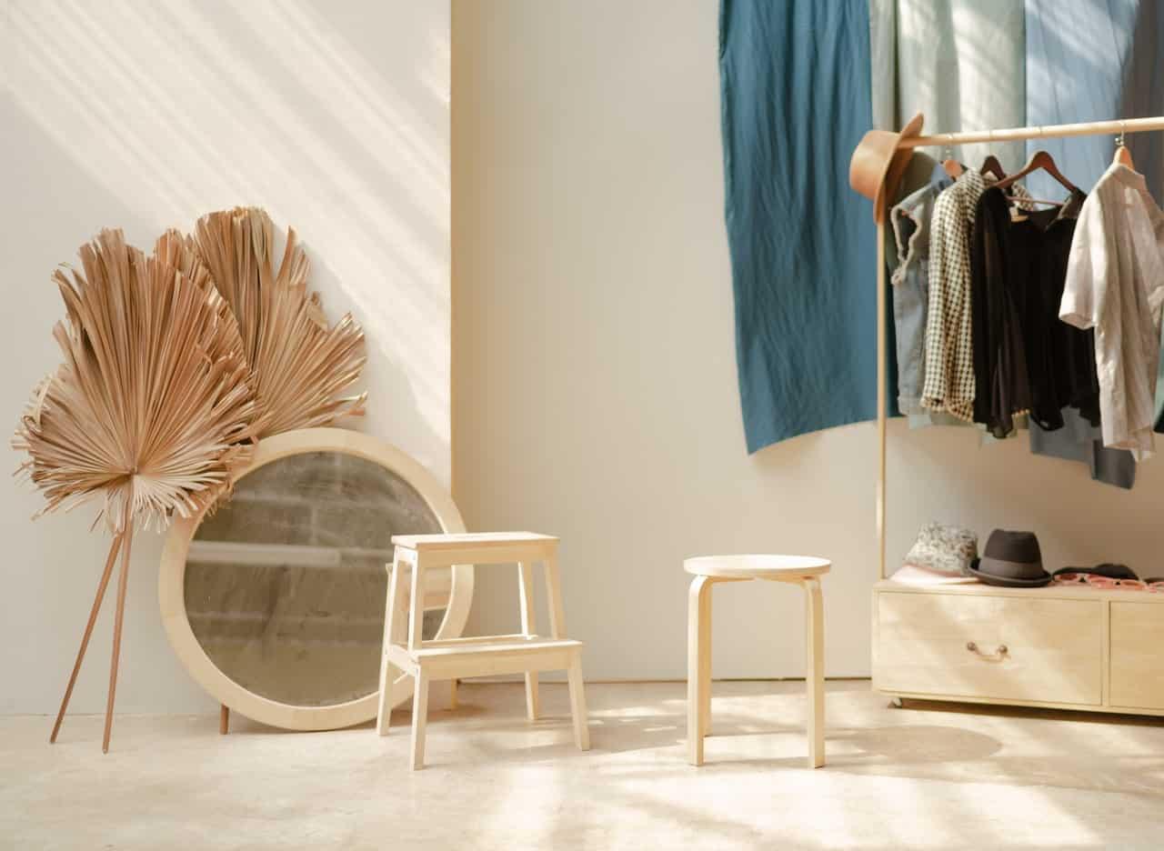 white-wooden-barstool-and-white-round-white-mirror-frame-3119180